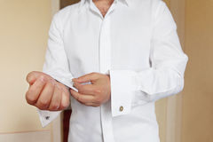 Man wears white shirt and cufflinks Royalty Free Stock Photography