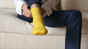 The man wears yellow socks stock footage