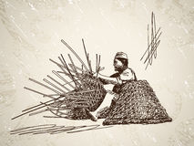 Man weaves a basket of bamboo Stock Photography