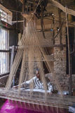 Man weaving with an acient Jacquart weaving machine. Stock Image