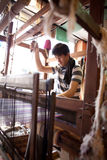 Man weaving carpet on traditional wooden loom Stock Photo