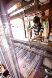 Man weaving carpet on traditional wooden loom Royalty Free Stock Images