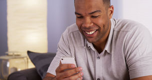 Man webcamming with mother on smartphone Royalty Free Stock Photos