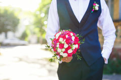 Man with wedding bouquet Stock Images