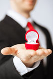 Man with wedding ring and gift box. Man making proposal with wedding ring and gift box Stock Photos