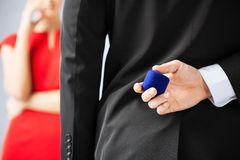 Man with wedding ring and gift box Royalty Free Stock Photography