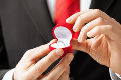 Man with wedding ring and gift box Stock Photo