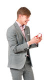 Man with wedding ring. Happy young man holding box with wedding ring, isolated on white background Stock Images