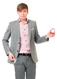 Man with wedding ring. Unhappy young man in suit holding box with wedding ring, isolated on white background Royalty Free Stock Photo