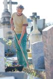 Man weeding in cemetary. Cemetary royalty free stock images