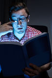 Man weeping with book. In dark room Stock Images