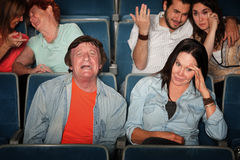 Man Weeps In Theater Royalty Free Stock Photos