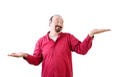 Man weighing up pros and cons with hands. Middle aged man with goatee weighing up pros and cons with hands on white Royalty Free Stock Image