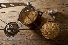 Man Weighs Malt for Home Brewing of Beer. Top View royalty free stock photos