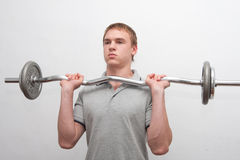 Man with weight bar Stock Photos