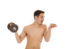 Man with weight and donut Stock Photos