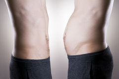 Man before and after weight loss. Fat and slim body Royalty Free Stock Photo
