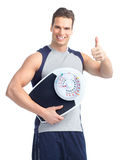 Man with a weight scale Stock Image