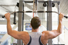 Man Weight Training At Gym Royalty Free Stock Photos