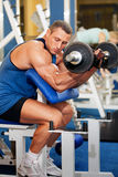 Man with weight training equipment on sport club Stock Photos