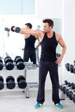 Man with weight training equipment on sport gym royalty free stock images