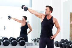 Man with weight training equipment on sport gym Stock Photo