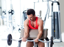 Man with weight training equipment on sport gym. Man with weight training equipmant on sport gym club Stock Images