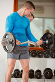 Man with weight training equipment Royalty Free Stock Photos