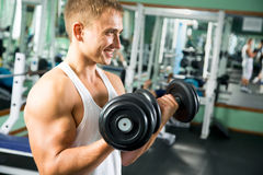 Man with weight training equipment stock photos