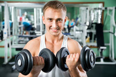 Man with weight training equipment royalty free stock photo