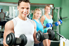 Man with weight training equipment Stock Images