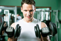 Man with weight training equipment Stock Image