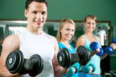 Man with weight training equipment Stock Photography