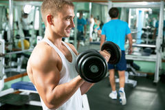 Man with weight training equipment royalty free stock images