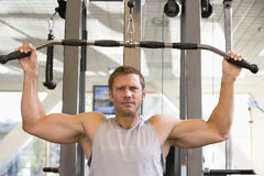 Man Weight Training At Gym Stock Image