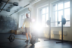 Man in Weightlifting Workout Royalty Free Stock Photography