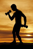 Man weights silhouette workout Stock Photography