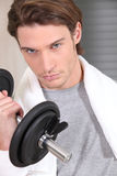 Man with weights Royalty Free Stock Images