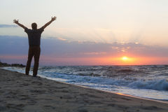 Man welcomes the sunrise on beach Royalty Free Stock Photography