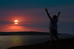 The man welcomes the sunset sun Royalty Free Stock Photography