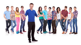 Man welcoming to his casual fashion team Royalty Free Stock Images