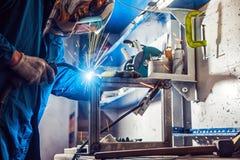 Man weld a metal welding machine Stock Photography