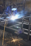 Man welding. Man with mask welding at steel construction at workshop stock photography