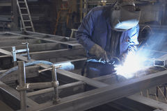 Man welding. Steel construction at industrial workshop stock images