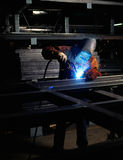 Man welding. Steel in shop setting Stock Photos
