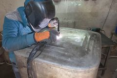 Man welding aluminum construction with TIG welder. Argon aluminum welding Royalty Free Stock Photos