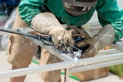 Welding aluminum bars together Royalty Free Stock Photo