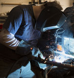 Man welding the bumper of a vehicle Royalty Free Stock Photos
