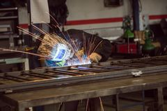 Free Man Welding Creating Sparks, Wearing Safety Equipment Stock Images - 143602074