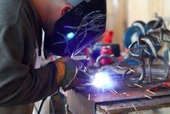 Man welding horse shoe art Royalty Free Stock Photos